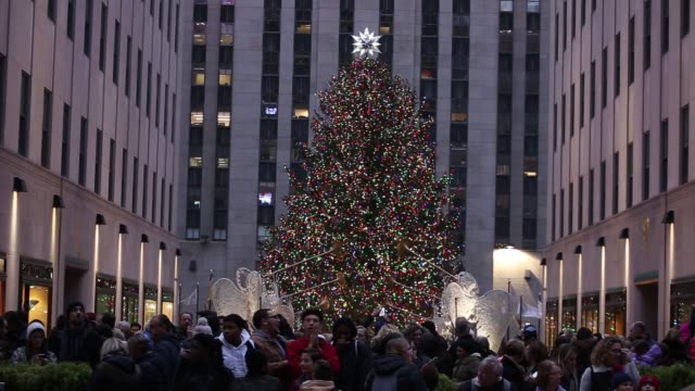 footage of the rockefeller center christmas tree during the holidays as pedestrians walk and shop in nyc on december 3 2017 photographer timothy... - rockefeller center christmas tree stock videos & royalty-free footage