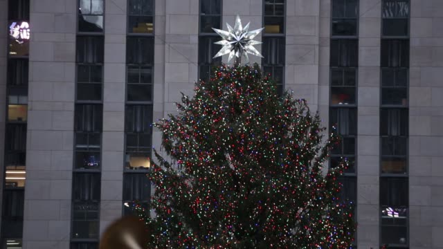 footage of the rockefeller center tree as well as pedestrians crowding around shopping area in nyc on december 3 2017 photographer timothy fadek... - rockefeller center christmas tree stock videos & royalty-free footage