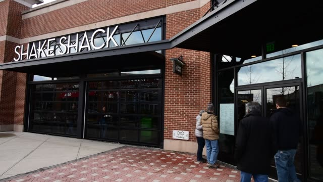 Footage of the Shake Shack Inc restaurant in Bridgewater New Jersey US on Friday March 4 2016 Shots wide pan left of people eating inside of...