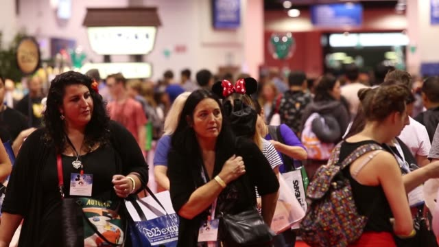 Footage of the show floor attendees and Disney balloons inside the D23 Expo 2017 at the Anaheim Convention Center in Anaheim CA on July 15 2017 Shots...