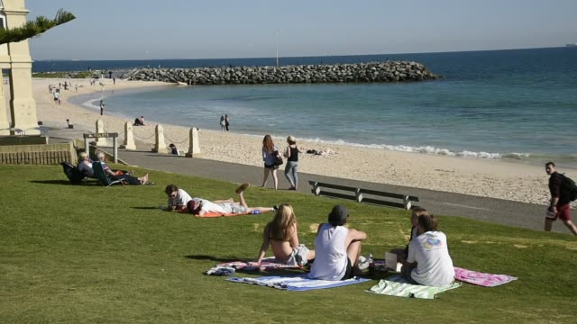 Footage of the town of Perth as pedestrians relax on May 31 2015 in Perth Australia Shots wide shto of the beach as people walk around and lounge...
