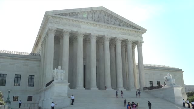 footage of the united states supreme court tourists walk in front of the court - oberstes bundesgericht der usa stock-videos und b-roll-filmmaterial