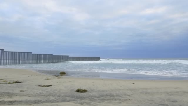footage of the u.s./mexico border on the shoreline of san diego, ca on october 30, 2017. photographer: dan acker - shots: wide pan right over border... - pair of compasses stock videos & royalty-free footage