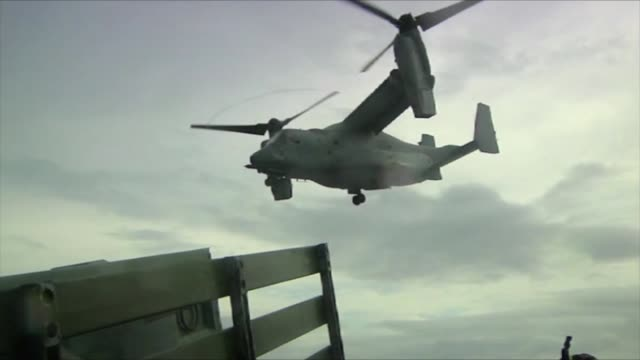 footage of the v22 osprey first time to ever land and takeoff aboard the uss ashland underway in the leyte gulf philippines - osprey stock videos & royalty-free footage