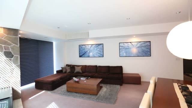 footage of the vale niseko building in kutchan japan on july 20 2016 shots wide shot of vale building interior shot of room with light coming through... - tea light stock videos and b-roll footage