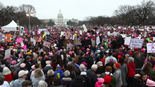 Footage of thousands of people marching during the Women's March in Washington DC on January 21 2017 Shots wide shot of huge crowd of protestors /...