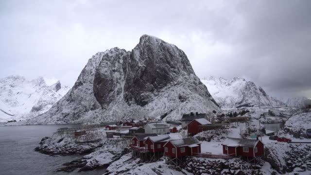 4k footage of top view land scape snow mountain with cloudy and lake of hamnoy village in lofoten islands, norway. moving down from top - ferry stock videos & royalty-free footage