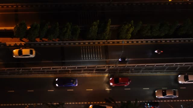 4k footage of traffic on the road from top view, night time bokeh from the car - headlight stock videos & royalty-free footage