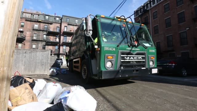 footage of trash collectors on their sunrise scavenger collection truck in the boston area, ma on march 29, 2016 shots wide shot of alleyway as two... - dustman stock videos & royalty-free footage