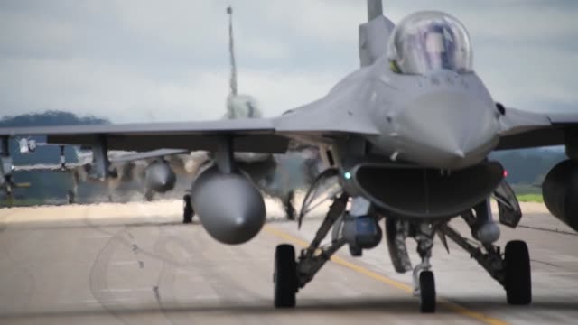 footage of various aircraft taxiing taking off and landing during exercise northern lightning 2019 - general dynamics f 16 falcon stock videos & royalty-free footage