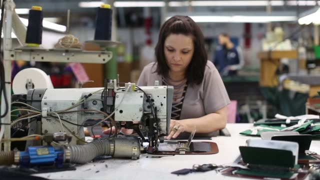 footage of workers using sewing machines at the joseph abboud facility in new bedford ma on march 22 2017 shots footage of woman sitting and using... - new bedford stock videos & royalty-free footage