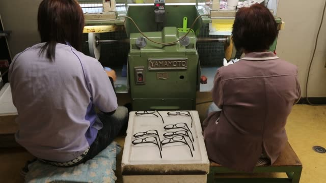 Footage on the production line of the factory at Makoto Optical COLTD in Sabae Fukui Prefecture Japan on Thursday Aug 18 2016 Shots pan left of...