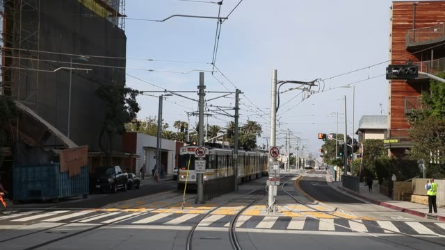 footage on the station platform and pedestrians near the platform of the metro expo line light train at a rail station in santa monica california us... - santa monica sign stock videos & royalty-free footage