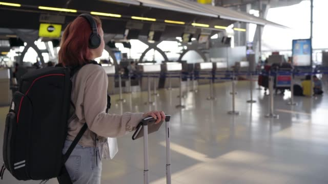 4k footage passengers in the airline walked the bag in the airport hall at twilight. - bag stock videos & royalty-free footage