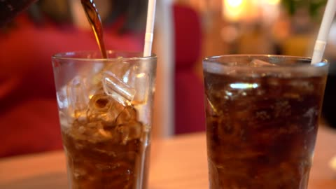 4k footage pour ice cola in the restaurant. - non alcoholic drink stock videos & royalty-free footage