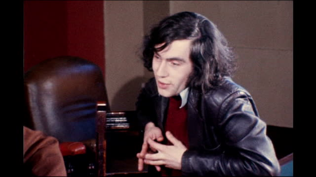 footage scotland: gordon brown with long hair in leather jacket chatting to michael foot - gordon brown stock-videos und b-roll-filmmaterial