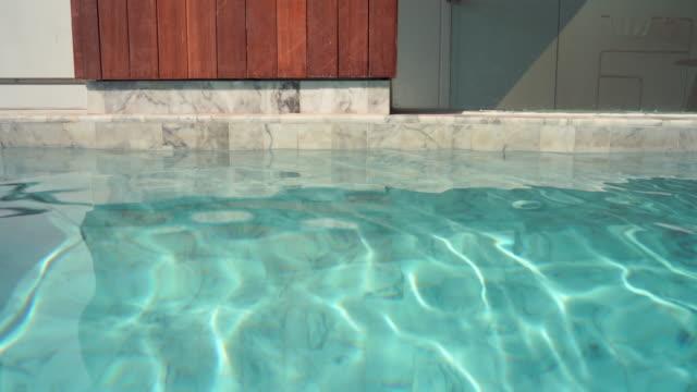 4k footage swimming pool villa. - standing water stock videos & royalty-free footage