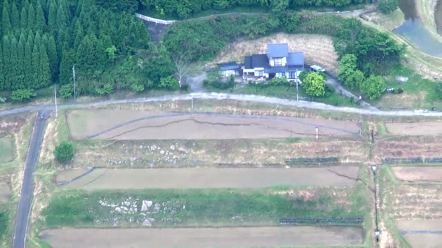 footage taken from a helicopter above bungoono oita prefecture shows large cracks in rice fields and near homes in a neighborhood evacuated in... - oita prefecture stock videos & royalty-free footage