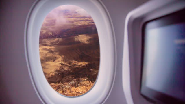 stockvideo's en b-roll-footage met footage taken from airplane window traveling around the world from the airplane seat view with stormy clouds. - collage