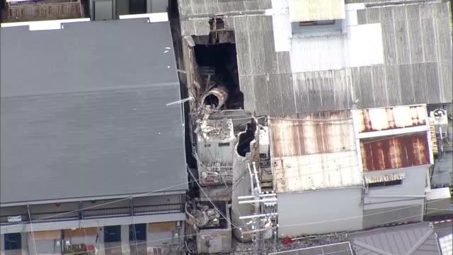 "footage taken from an asahi shimbun helicopter shows the wrecked chimney of a ""sento"" japanesestyle public bathhouse in hirakata osaka prefecture... - ストライキ点の映像素材/bロール"