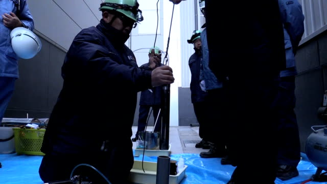 Footage taken on February 7 Japan shows specialists gathering groundwater samples for retesting to check for toxic substances at the Toyosu wholesale...