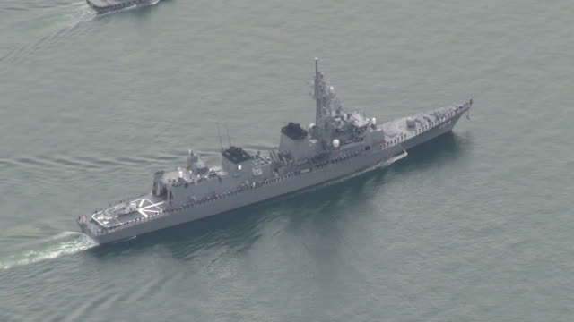 Footage taken on November 20 Japan shows the Maritime SelfDefense Force escort vessel Kirisame displacing 4550 tons leaving its base in Sasebo...