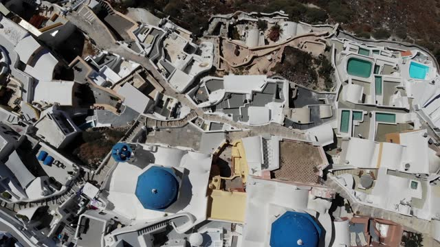 footage - top down aerial drone panoramic video of the world-famous picturesque traditional mediterranean village of oia in the volcanic island of... - oia santorini stock videos & royalty-free footage
