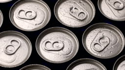 footage water droplets on can of soda or beer rotate background