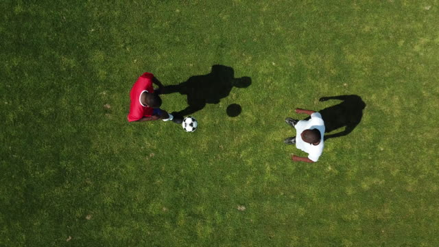 football, aerial view, football players to warm up - sportsperson stock videos & royalty-free footage