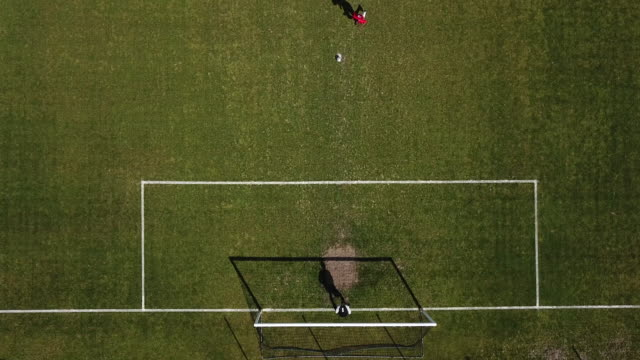 football, aerial view, penalty, goal - goalkeeper stock videos & royalty-free footage
