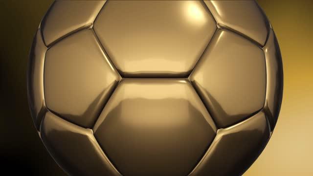 4k fußball-animation auf goldenen farbverlauf hintergrund loopable - ball stock-videos und b-roll-filmmaterial