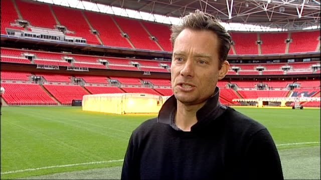 blue plaque unveiled at wembley close shots red stadium seats / gvs wembley stadium and pitch / tom steward interview sot / steward talking to... - football association stock videos & royalty-free footage