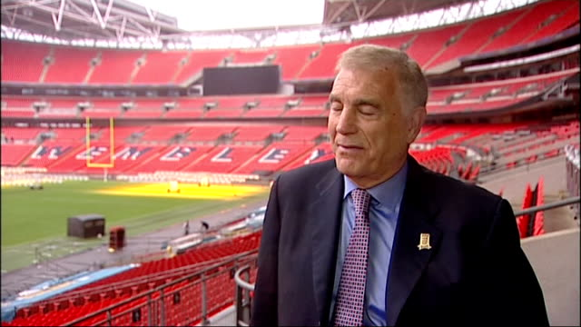 blue plaque unveiled at wembley ext sir trevor brooking interview sot / johannes gunnell and rob smettem interview sot - football association stock videos & royalty-free footage