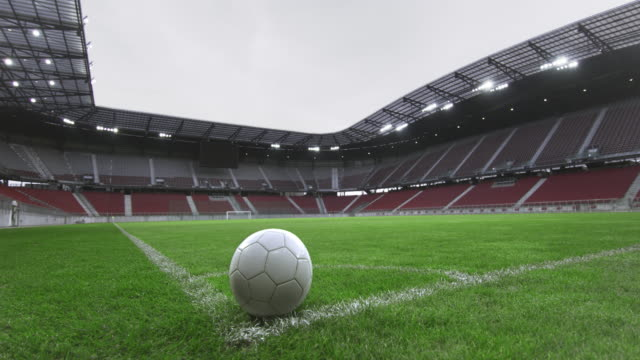 ds football ball in the corner of an empty stadium - barren stock videos & royalty-free footage
