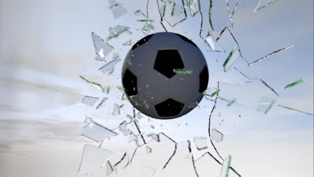 Football breaking glass slow motion