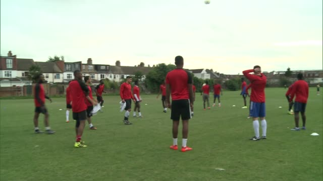 football club set up after london riots competes in the fa cup london croydon ac london players at training session prince choudary along pitch and... - itv london lunchtime news stock-videos und b-roll-filmmaterial