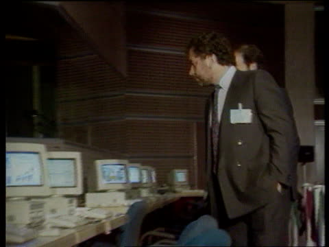 bskyb victory disputed by itv ms alan sugar along looking at computers cms poster advertising amstrad satellite dishes ms satellite equipment for... - alan sugar stock videos and b-roll footage