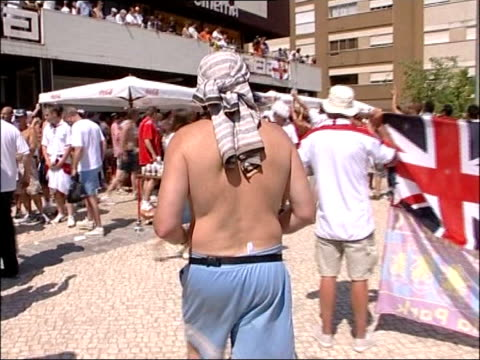 euro 2004 england win against switzerland itn gv town of coimbra town seen across river pan giant st george's flag flying from side of bridge swiss... - bikini top stock videos & royalty-free footage