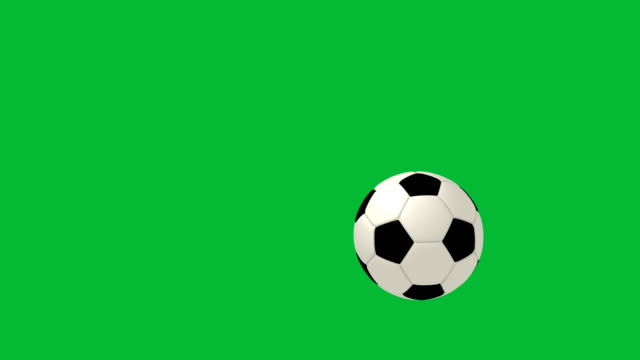 football falling on green chroma key background - rimbalzare video stock e b–roll