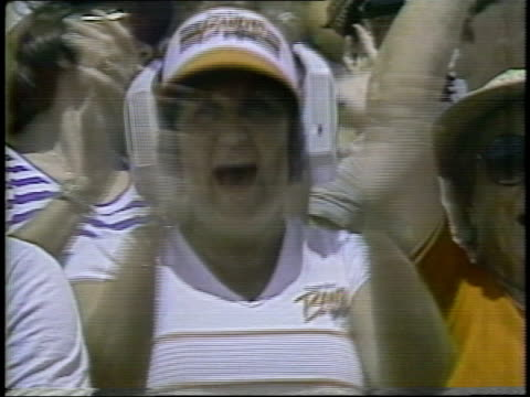 1983 ms football fan clapping, cheering and wearing large headphones during usfl game / usa - fan enthusiast stock videos & royalty-free footage