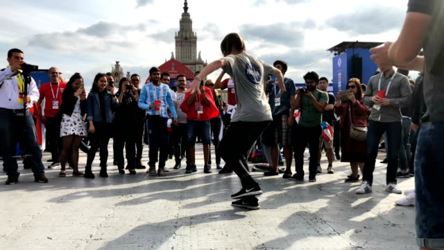 a football fan from russia cossack dances at the official fifa fan fest at moscow state university where fans will watch the first world cup game... - fifa world cup 2018 stock videos & royalty-free footage