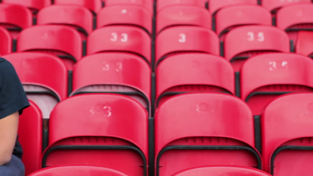 football fan in empty stadium looking depressed - fan enthusiast stock videos & royalty-free footage