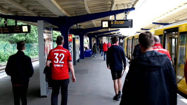 Football fans arrive at the Olympiastadion subway station prior the DFB Cup final between RB Leipzig and Bayern Muenchen at Olympiastadion on May 25...