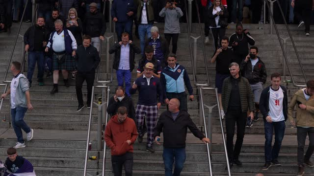 football fans arrive at wembley stadium for the euro2020 england vs scotland game on june 18, 2021 in london, england. england v scotland is not only... - other stock videos & royalty-free footage