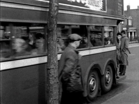 football fans arrive at west ham football ground via a bus. - doppeldeckerbus stock-videos und b-roll-filmmaterial