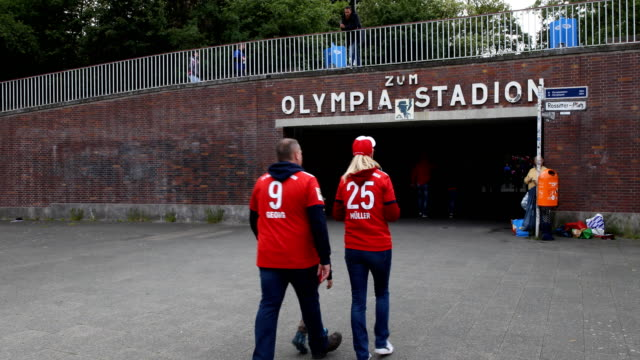 Football fans from Bayern Munich arrive at the Olympiastadion subway station prior the DFB Cup final between RB Leipzig and Bayern Muenchen at...