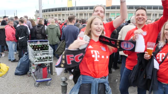 Football fans from FC Bayern Munich in good mood at the entrance to the stadium ahead of the DFB Cup Final 2019 between RB Leipzig and Bayern...