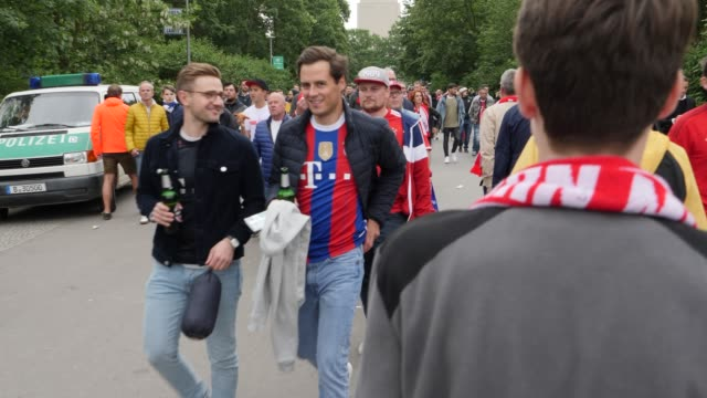 Football fans from FC Bayern Munich on the way to the entrance of the stadium ahead of the DFB Cup Final 2019 between RB Leipzig and Bayern Muenchen...
