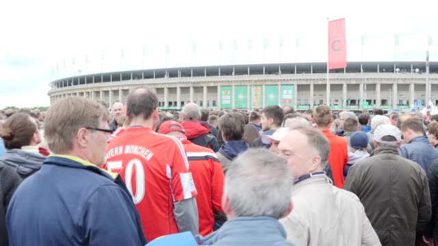 Football fans from FC Bayern Munich waiting for the entrance to the stadium ahead of the DFB Cup Final 2019 between RB Leipzig and Bayern Muenchen at...