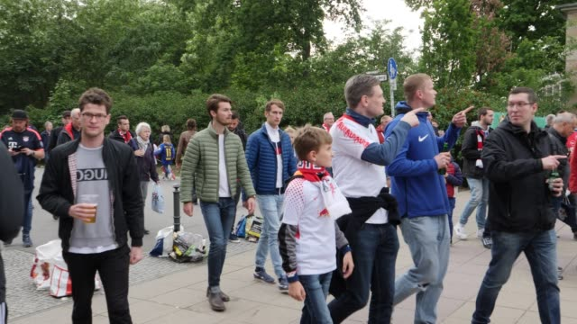 Football fans from RB Leipzig and FC Bayern Munich in front of the stadium in the area where most Bayern Munich fans are ahead of the DFB Cup Final...